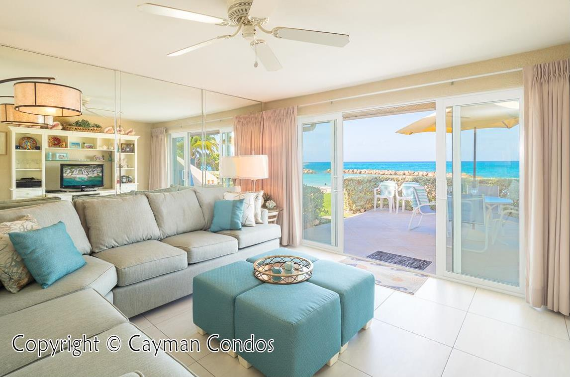 Living room with sliding door to oceanfront patio